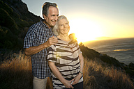 South Africa, portrait of happy senior couple at sunset - TOYF000724
