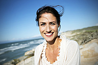 South Africa, portrait of smiling woman with blowing hair - TOYF000764