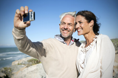 South Africa, smiling couple taking a selfie head to head - TOYF000767