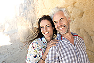 South Africa, portrait of happy couple in front of a rock face - TOYF000784