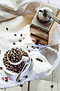 Old coffee mill and coffee cup filled with coffee beans - SBDF001907