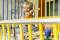 Portrait of happy little boy sitting in children's hospital bed having breakfast - MFF001621