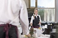 Restaurant staff setting tables - ZEF005133