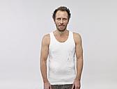 Portrait of man wearing white vest - RH000870