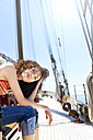 Brunette young woman on a sailing ship - TOYF000835