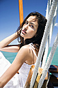 Brunette young woman on a sailing ship - TOYF000841
