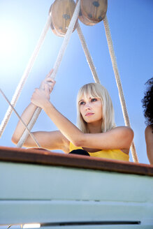 Blond young woman on a sailing ship - TOYF000849