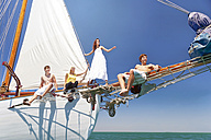 Friends on bow of a sailing ship - TOYF000854