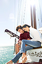 Happy young couple on a sailing ship - TOYF000881