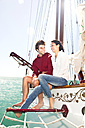 Happy young couple on a sailing ship - TOYF001042