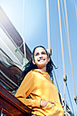 Smiling young woman on a sailing ship - TOYF000900