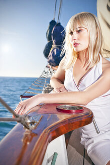 Blond young woman on a sailing ship - TOYF000934