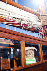 Young woman in cabin on a sailing ship - TOYF000946