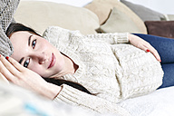 Portrait of pregnant woman relaxing on the couch - SEGF000372
