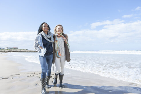 South Africa, Cape Town, two friends walking on the beach - ZEF005268