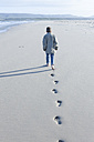 South Africa, Cape Town, back view of a boy walking on the beach - ZEF005240