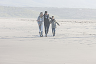 South Africa, Cape Town, family walking on the beach - ZEF005245