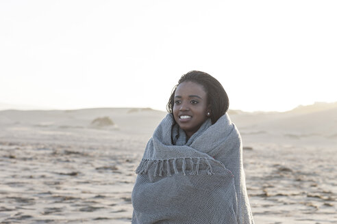 South Africa, Cape Town, portrait of young woman standing on the beach - ZEF005262