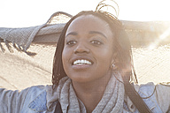 Portrait of smiling young woman at backlight - ZEF005263