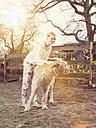 Woman stroking Irish Wolfhound - TAMF000171