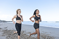 South Africa, Cape Town, two women jogging on the beach - ZEF005195