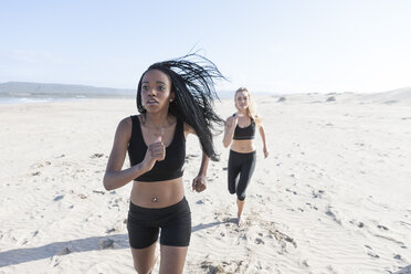 South Africa, Cape Town, two women jogging on the beach - ZEF005200