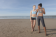 South Africa, Cape Town, two joggers taking a break on the beach - ZEF005222