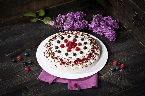 Raspberry-cream cake garnished with blueberries and raspberries - MAEF010596