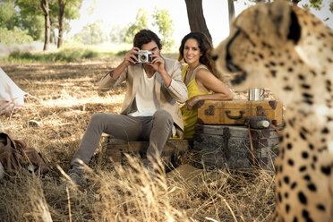 South Africa, couple photographing cheetah - TOYF000967