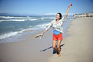 South Africa, happy woman dancing on the beach - TOYF001014