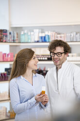 Pharmacist advising female customer - FKF001066