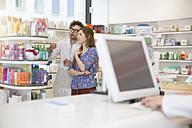 Pharmacist advising female customer - FKF001099