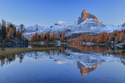 Italy, Dolomites, Belluno, mountain Becco di Mezzodi reflecting in Federa Lake at sunset - RUEF001614