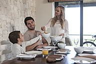 Family having lunch at dining room table - ZEF005372
