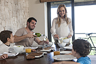 Family having lunch at dining room table - ZEF005374