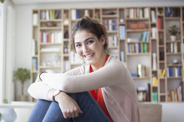 Portrait of smiling young woman at home - RBF002873