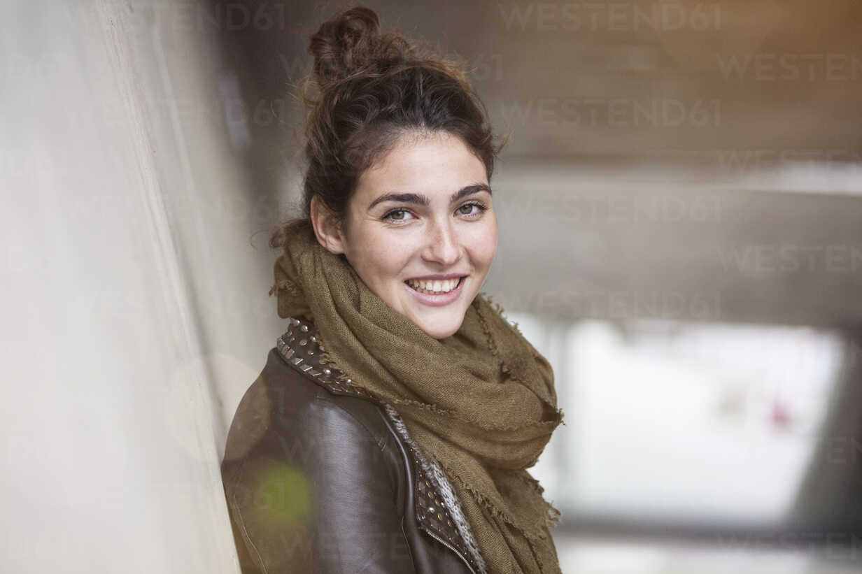 Portrait of smiling young woman with bun - RBF002891 - Rainer Berg/Westend61