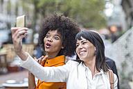Two friends posing for a selfie - ZEF007046