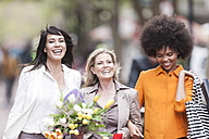 Portrait of three happy women side by side on shopping tour - ZEF006601