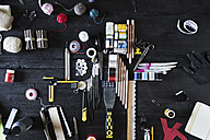 Arrangement of craft materials and tools on black wood - PDF000953