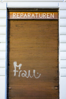 Closed shutter with graffiti woman, concept beauty craze - EJWF000760