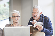 Senior couple using laptop together - ZEF005506