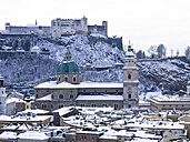Austria, Salzburg State, Salzburg, Old town, View to Salzburg Cathedral and Hohensalzburg Castle in winter - AMF004055