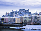 Austria, Salzburg, Old town, Salzach river, Hohensalzburg Fortress and churches in winter - AMF004056