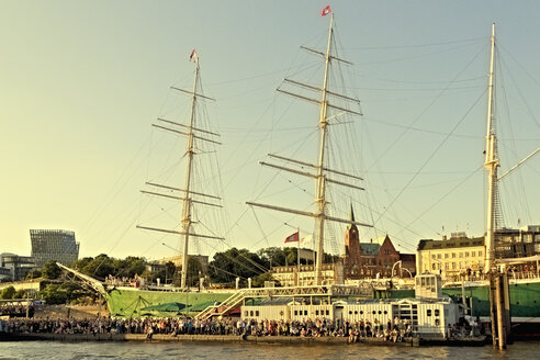 Germany, Hamburg, People at the annual Harbour Fest, Rickmer Rickmers sailing ship in background - MEM000754