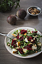Plate of beetroot salad with rocket and walnuts - EVGF001833