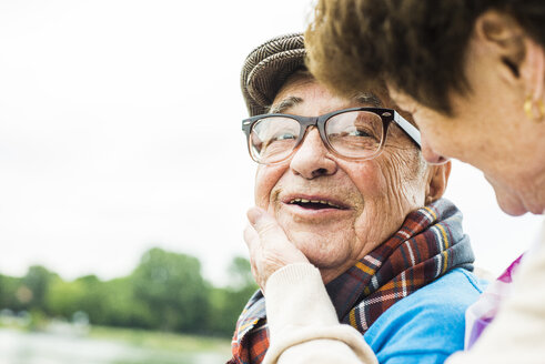 Portrait of happy senior man face to face with his wife - UUF004514