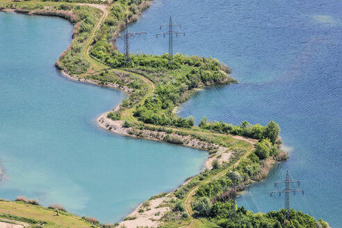 Germany, Eichstaett District, land bridge with power pylons between two gravel pits - KLEF000004