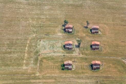Italy, Apulia, aerial view of six abandoned farmhouses in between harvested field - KLEF000007
