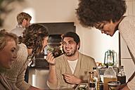 Friends preparing food together - ZEF006275